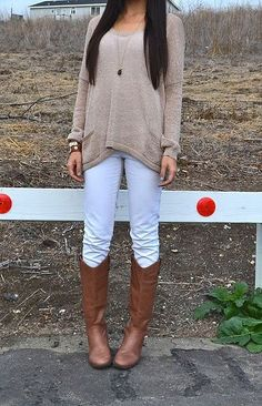 White jeans with a slouchy top and boots