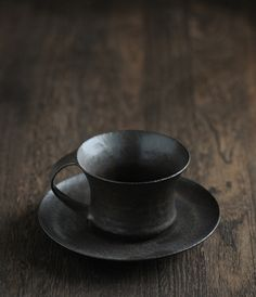 cups September 8th, 2011  black glaze and ash glaze cups from sfera    yunomi (teacup) ¥2,000 cup and saucer ¥3,400