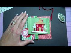 Learn how to make a joy fold card with Christmas with the Cricut!  It's a quick and easy card - A2 sized - made using SEI Christmas Mint double sided cardstock paper and a beautiful Winter house cut from the Joys of the Season Cricut cartridge!