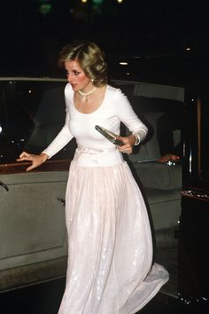DECEMBER 1984 - The Princess chose a shimmering sequin maxi dress for an evening event in London.