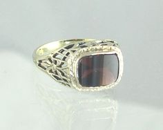 This is an antique ring with a rectangular garnet.