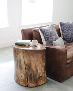 When we bought our property we had a few rogue walnut trees and my husband was determined to reuse or recycle every bit of them. His side table in our great room was one project. And yeah, we have his & hers sofas because he's a hard working man and needs rugged furniture to plop down on without worries. Mine's linen. PS. I need a rug in here.