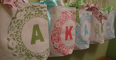 canvas tote bags stenciled with doilies and freezer paper