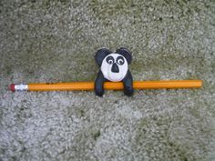 clay panda has a magnetic to hold pencils made by tamacole designs
