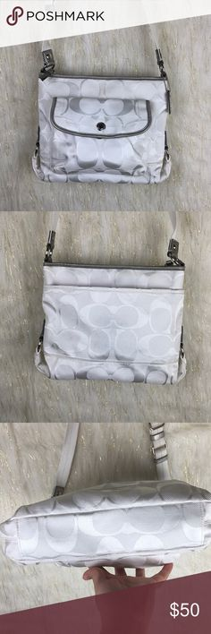 """COACH Kyra Daisy white purse Coach Daisy kyra white purse nylon canvas in the classic signature pattern with patent leather trim and silver hard ware, adjustable strap drips 14-21"""" leather signature hang tag, back slip pocket and front flap pocket in pristine condition Coach Bags Crossbody Bags"""