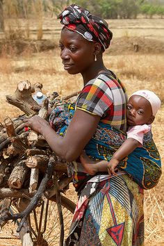 A mother her child gathering wood, Banfora, Burkina Faso.