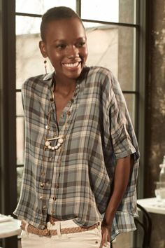 Anthropologie  Halsey Buttondown - I could care less about the shirt. I repinned because of how beautiful this woman is. There was no need for the photo shop on her arms. I have a feeling she was skinny enough already.