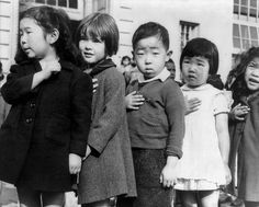 August 1942....First-graders, some of Japanese ancestry, at the Weill public school, San Francisco, Calif., pledging allegiance to the United States flag. The evacuees of Japanese ancestry will be housed in War relocation authority centers for the duration of the war SUMMARY: Relocation of Japanese-Americans. Calif.