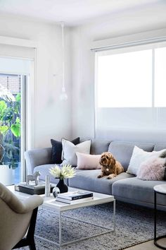 A modern Scandinavian-style living room with grey sofa and blush pink tones. Living Room Pillows, Living Room Storage, Living Room Decor, Interior Design Courses, Decor Interior Design, Interior Decorating, Scandinavian Style Home, Boutique Homes, Living Area