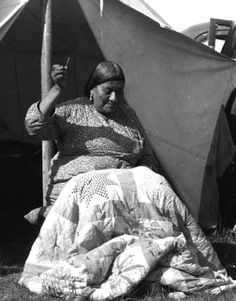 PICTURED: An unidentified Lakota quilter works on a patchwork quilt with Star blocks. Photo courtesy of Buechel Memorial Lakota Museum.