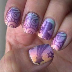 I LOVE this pastel nail design! Just in time for Easter! Plus it has unicorns and stars! How cute! source: Stampaholic Nail Art on blogspot.