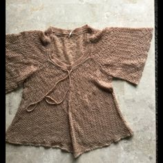 Free People crochet tie in front sweater L NWOT Free people crochet tie in front sweater L. No snags flaws etc Free People Sweaters