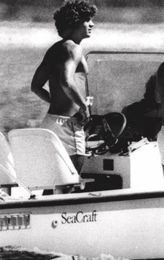 John F. Kennedy, Jr. spends a late summer day at the helm of a small power boat off the shore near his home in Hyannisport, Massachusetts, Sunday, Sept. l9, 1979.
