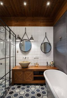 Circle mirrors - hexagon floor tiles - subway tiles - lots of different shapes in this bathroom