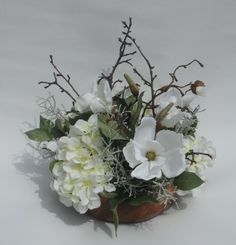 Spring magnolia and hydrangea romantic centerpiece by ArtiFlora