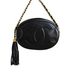 1980's CHANEL oval black leather 'CC' bag with gilt chain   From a collection of rare vintage shoulder bags at https://www.1stdibs.com/fashion/handbags-purses-bags/shoulder-bags/