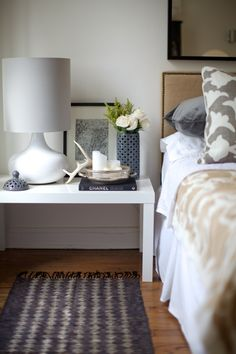 nailhead uphostered headboard, vented lantern as a vase, and west elm lamp.  love the antlers too.  rue