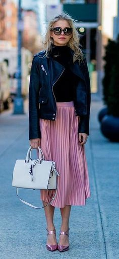 pink pleated skirt. leather jacket. street style.