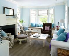 Sara Tuttle Interiors - living rooms - sky blue walls, blue walls, blue living room walls, hardwood floors, striped sisal rug, sisal area ru...