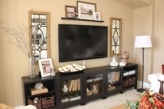 TV stand styling inspiration. Love the mirrors on each side.