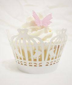 Paper cases to match the Birdcage theme cake. Pink butterflies to match table scatter butterflies.