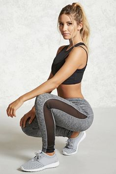 A pair of active leggings featuring a marled knit pattern, side mesh panels, and a hidden key pocket.