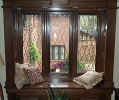 pictures of english tudor cottages | ... glass, enhance the view from the relaxing bench in the Garden Cottage
