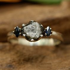 Rough diamond ring with tiny marquis blue sapphire side set gems in prongs setting with sterling silver band