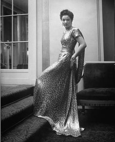 Late 40s evening gown long dress Mary Damon wearing Adrian leopard print dress. Location: New York, NY, US Date taken: 1949 Photographer: Nina Leen