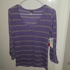 NWT Roxy 3/4 sleeve purple top Purple and light grey stripes. Loose fitting and light materiel. Unbuttons for long sleeves. Roxy exclusive. Never worn. PacSun Tops Tees - Long Sleeve