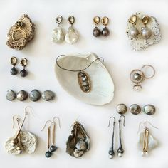 Different pieces from my jewelry collection of earrings, rings and necklaces with a variety of pearls