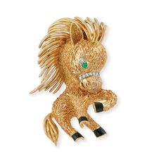 Gold, Enamel, Emerald and Diamond Horse Clip-Brooch, Van Cleef & Arpels 18 kt., the textured gold prancing horse with flowing polished gold ...