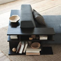 Like the partial wrap around for large couch.  Bookshelf Side Table by West Elm - IcreativeD