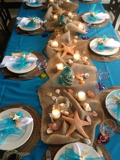 Beach reception tablescape table setting display starfish burlap blue aqua