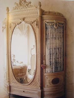 An extraordinary antique armoire. So many ideas for this one and so pretty. #OrganizeIt #StorageMart