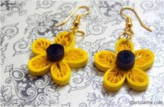 quilled ear ring made using comb