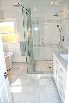 gorgeous bathroom! Amazing makes this small bathroom seem huge and luxurious. Would love heated floors.