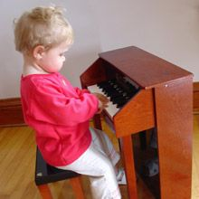 Hannah carefully checks out her new spinet upright Piano, Toy, Stars, Gallery, Decor, Tools, Musica, Decoration, Toys
