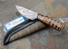 Sam Stoner, Scottsville, KY Custom Skinner/ Hunter w/ DAMASCUS and MAMMOTH MOLAR with unique handmade Rattlesnake/Leather deep carry sheath. #samstoner #amish #amishknifemaker #mammoth #mammothmolar #knives #knife #blades #handmadeknife