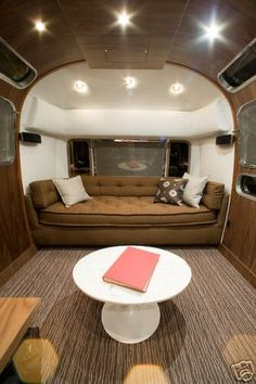 Airstream: I am beginning to think I want a trailer as my art studio.... with a bed like this on one end.