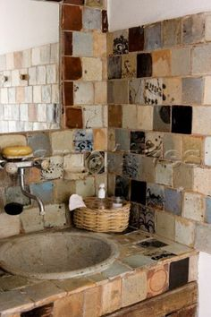 ceramic sink and handmade ceramic tiles by Anne Kjaersgaard