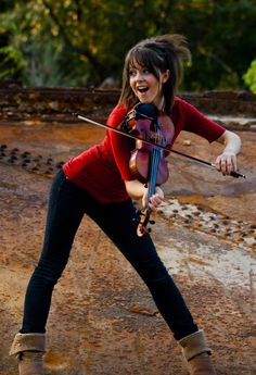 """There is no-one else like classically trained violinist Lindsey Stirling. Reaching 2010's America's Got Talent quarter finals strengthened Stirling's resolve to be herself. Her debut album has sold 200,000 copies in the US without the backing of a major label. Her You Tube channel has over 4 million subscribers and she has 85 million hits with her song """"Crystallize"""". Her shows are now selling out dates across Europe, America, Russia and Asia. http://www.lindseystirling.com/"""