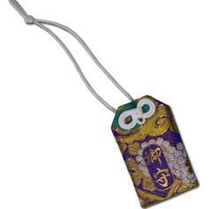 The Japanese people believe that omamori is a charm that protects the holder and gives good luck. These are sold generally at temples and can be hung wherever the owner needs it the most. This is an all purpose good luck charm with a purple dragon print, and used to bring you good luck whenever you need it most - be it a final examination or getting that new job.