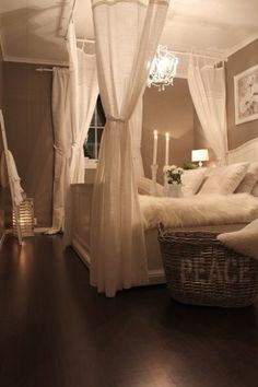 I have always wanted to hang curtains around my bed like this...so romantic!!