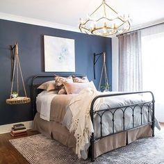 A Hale Navy HC-154 accent wall creates a beautiful contrast with Wickham Gray…