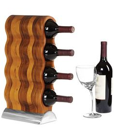With its sinuous shape in smooth wood, the Nambe Curvo wine rack adds a modern element to any room. Designed by Steve Cozzolino for Nambe. | Wood/metal alloy | Care: Hand wash | Imported | Dimensions: