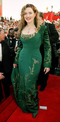 Emerald green gown by Givenchy on Kate Winslet at the 1998 Oscars. Horseshoe neckline with draping and beading, long sleeves, and beautiful detailed botanical embroidery with dragonfly on long skirt.