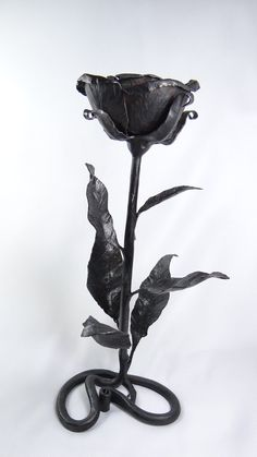 most fav. Metal Rose Decorative Iron Rosebud - hand-forged flower with leaves - black iron flower sculpture. $289.00, via Etsy.