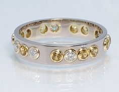 "I Love this - it is a morse code ring! the  diamond and yellow sapphire spell out ""marry me"" in morse code!"