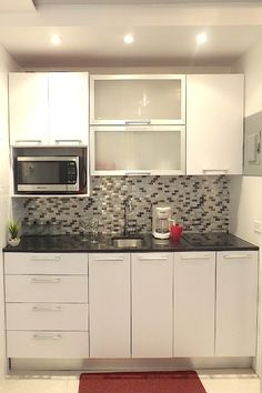 Microwave off the worktop Lots of cabinets to accommodate cookware, coffee maker, blender, rice maker, etc Kitchen Furniture, Kitchen Interior, Kitchen Decor, Kitchen Design, Laundry Room Cabinets, Kitchen Cabinets, Tiny Bedroom Storage, Cheap Interior Wall Paneling, Narrow Kitchen